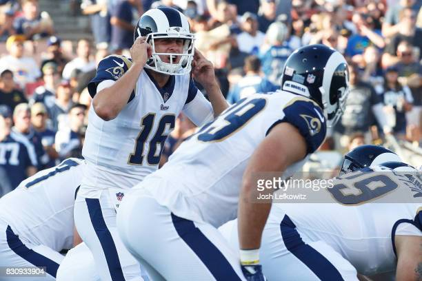 Jared Goff of the Los Angeles Rams communicates during the preseason game against the Dallas Cowboys at the Los Angeles Memorial Coliseum on August...