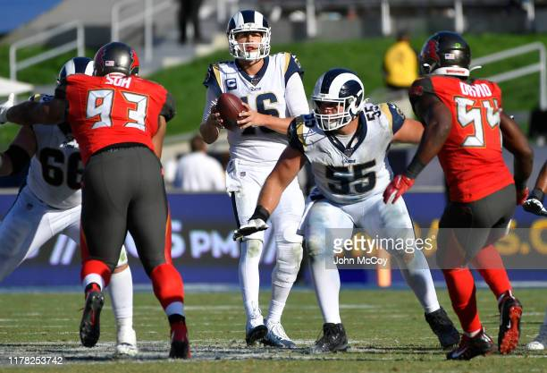 Jared Goff of the Los Angeles Rams drops back while Austin Blythe and Brian Allen block Ndamukong Suh of the Tampa Bay Buccaneers and Lavonte David...