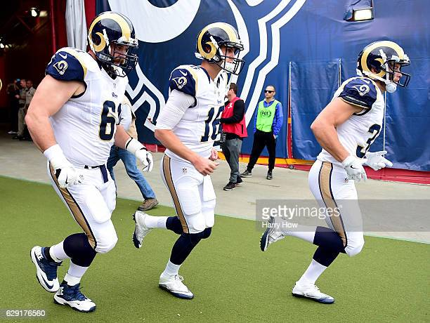 Jared Goff of the Los Angeles Rams enters the field with Tim Barnes and Chase Reynolds before the game against the Atlanta Falcons at Los Angeles...