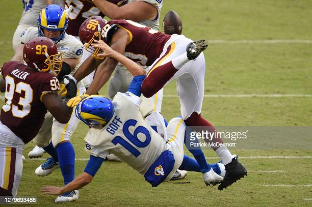 Jared Goff of the Los Angeles Rams fumbles the ball as he is hit by Montez Sweat of the Washington Football Team in the second half at FedExField on...