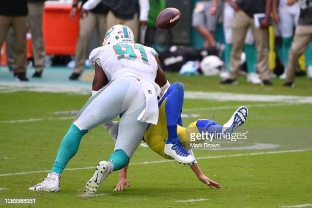 Jared Goff of the Los Angeles Rams fumbles the ball on a hit by Emmanuel Ogbah of the Miami Dolphins during their NFL game at Hard Rock Stadium on...