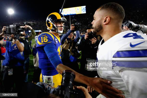 Jared Goff of the Los Angeles Rams greets Dak Prescott of the Dallas Cowboys after the NFC Divisional Playoff game at Los Angeles Memorial Coliseum...