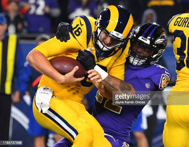 Jared Goff of the Los Angeles Rams is sacked by Jimmy Smith of the Baltimore Ravens in the first quarter of the game at the Los Angeles Memorial...