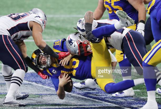 Jared Goff of the Los Angeles Rams is sacked in the first half during Super Bowl LIII against the New England Patriots at Mercedes-Benz Stadium on...