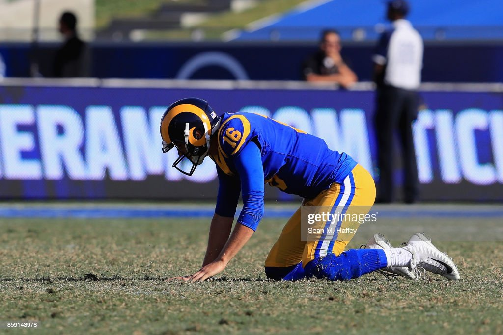 Jared Goff #16 of the Los Angeles Rams kneels after throwing an interception during the second half of a game against the Seattle Seahawks at Los Angeles Memorial Coliseum on October 8, 2017 in Los Angeles, California.