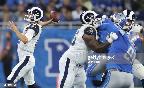 Jared Goff of the Los Angeles Rams looks down field to pass against the Detroit Lions during the first quarter at Ford Field on December 2 2018 in...