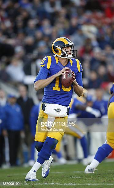 Jared Goff of the Los Angeles Rams looks for an open receiver during the game against the San Francisco 49ers at the Los Angeles Coliseum on December...