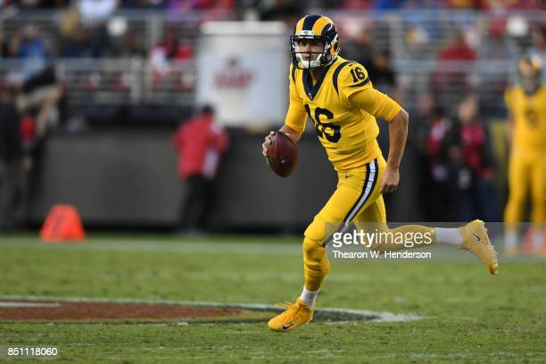 Jared Goff of the Los Angeles Rams looks to pass against the San Francisco 49ers during their NFL game at Levi's Stadium on September 21 2017 in...
