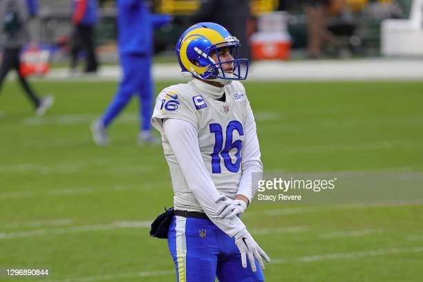 Jared Goff of the Los Angeles Rams participates in warmups prior to the NFC Divisional Playoff game against the Green Bay Packers at Lambeau Field on...