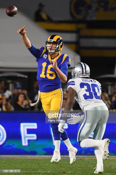 Jared Goff of the Los Angeles Rams passes in the first quarter against the Dallas Cowboys in the NFC Divisional Playoff game at Los Angeles Memorial...