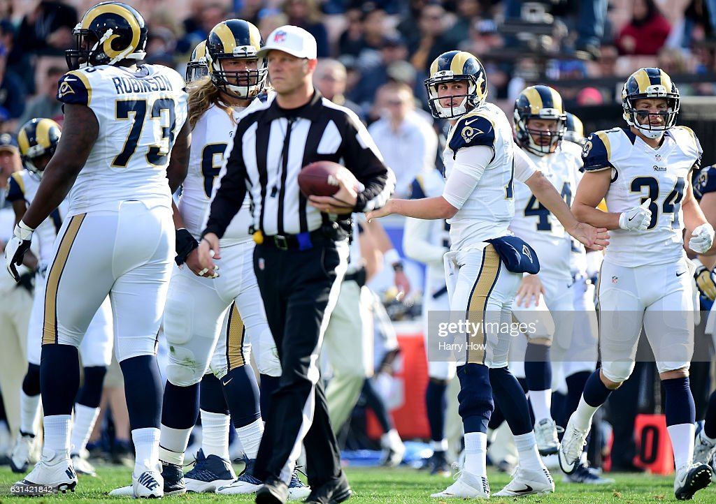 Jared Goff #16 of the Los Angeles Rams reacts as he leaves the field after a failed third down play against the Arizona Cardinals at Los Angeles Memorial Coliseum on January 1, 2017 in Los Angeles, California.