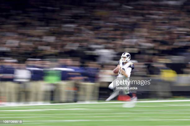 Jared Goff of the Los Angeles Rams runs the ball against the New Orleans Saints during the second quarter in the NFC Championship game at the...