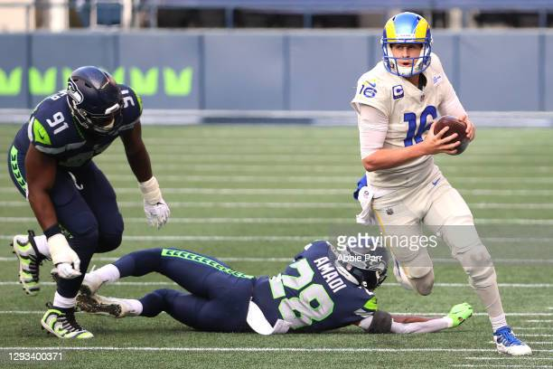 Jared Goff of the Los Angeles Rams runs with ball after breaking a tackle against Ugo Amadi of the Seattle Seahawks in the first quarter at Lumen...