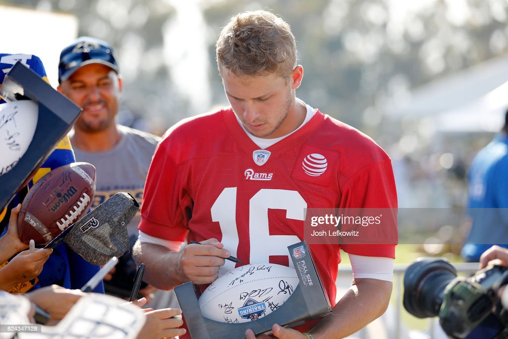 Jared Goff #16 of the Los Angeles Rams signs autographs following the first day of Training Camp at Crawford Field on July 29, 2017 in Irvine, California.