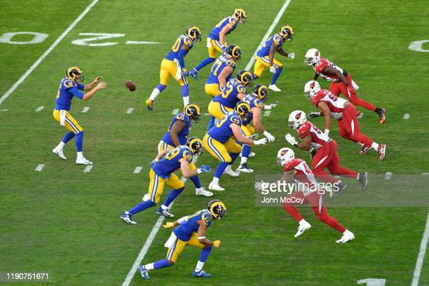 Jared Goff of the Los Angeles Rams takes a snap against the Arizona Cardinals in the second quarter at Los Angeles Memorial Coliseum on December 29,...