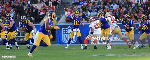 Jared Goff of the Los Angeles Rams throws a pass during the second half against the San Francisco 49ers at Los Angeles Memorial Coliseum on December...