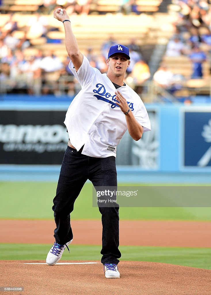 Jared Goff #16 of the Los Angeles Rams throws out a ceremonial first pitch before the game against the Colorado Rockies at Dodger Stadium on June 6, 2016 in Los Angeles, California.
