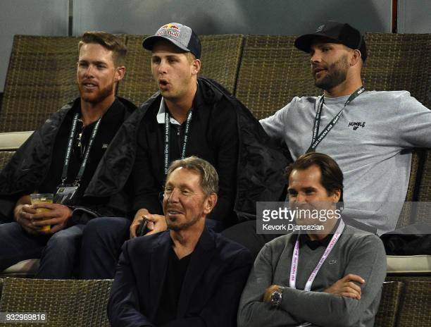 Jared Goff quarterback of the Los Angeles Rams seated behind Oracle Cofounder Larry Ellison and tournament director Tommy Hass attend Naomi Osaka of...