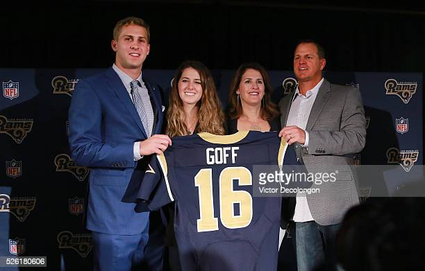 Jared Goff the Los Angeles Rams first pick and first overall pick of the 2016 NFL Draft and his family hold up his jersey after the press conference...