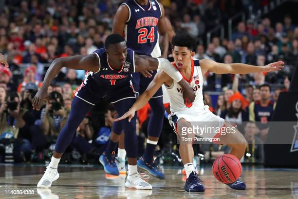 Jared Harper of the Auburn Tigers battles for the ball with Kihei Clark of the Virginia Cavaliers in the first half during the 2019 NCAA Final Four...