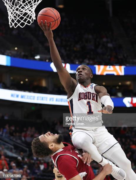 Jared Harper of the Auburn Tigers drives to the basket during the first half against the New Mexico State Aggies in the first round of the 2019 NCAA...