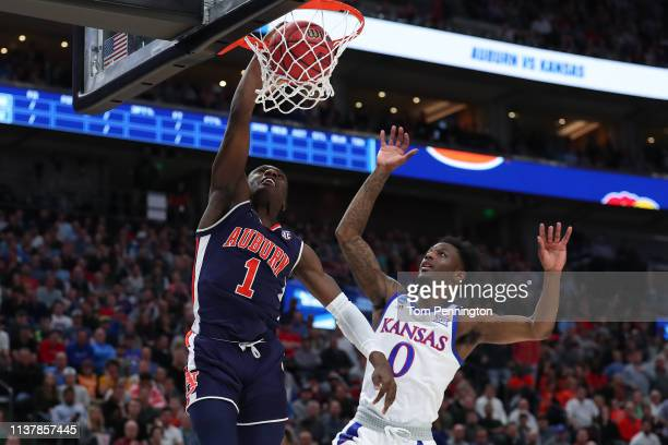 Jared Harper of the Auburn Tigers dunks the ball against the Kansas Jayhawks during their game in the Second Round of the NCAA Basketball Tournament...