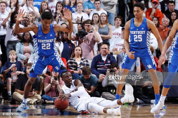 Jared Harper of the Auburn Tigers falls to the floor while defended by Shai GilgeousAlexander of the Kentucky Wildcats in the first half of a game at...