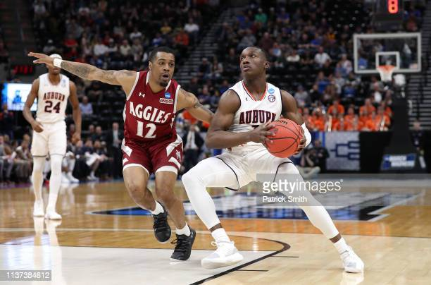 Jared Harper of the Auburn Tigers handles the ball against AJ Harris of the New Mexico State Aggies during the first half in the first round of the...