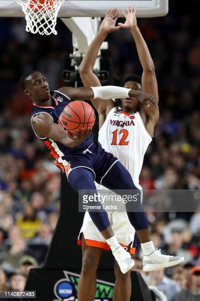 Jared Harper of the Auburn Tigers handles the ball against De'Andre Hunter of the Virginia Cavaliers in the second half during the 2019 NCAA Final...