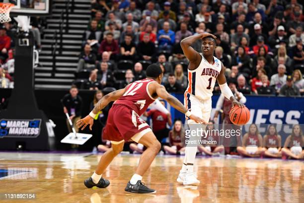 Jared Harper of the Auburn Tigers leads the offense around AJ Harris of the New Mexico State Aggies The Auburn Tigers take on the New Mexico State...