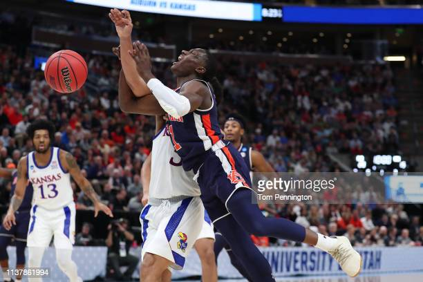 Jared Harper of the Auburn Tigers loses the ball against the Kansas Jayhawks during their game in the Second Round of the NCAA Basketball Tournament...