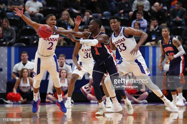 Jared Harper of the Auburn Tigers passes the ball against the Kansas Jayhawks during their game in the Second Round of the NCAA Basketball Tournament...