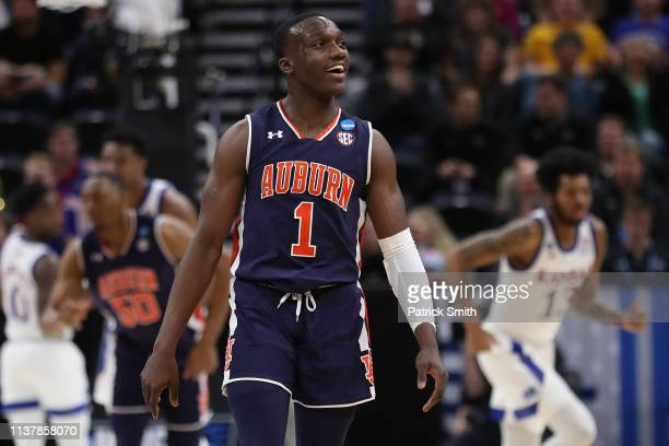 Jared Harper of the Auburn Tigers reacts to a play against the Kansas Jayhawks during their game in the Second Round of the NCAA Basketball...