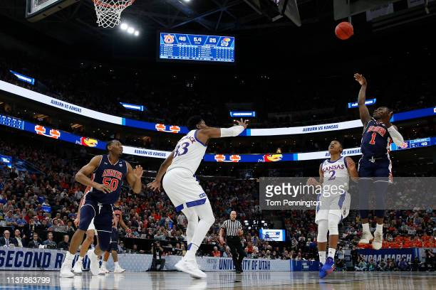 Jared Harper of the Auburn Tigers takes a shot against the Kansas Jayhawks during their game in the Second Round of the NCAA Basketball Tournament at...