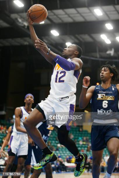 Jared Harper of the Northern Arizona Suns drives to the basket during the second quarter against Jaylen Hoard of the Texas Legends on January 31 2020...