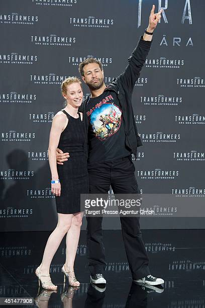 Jared Hasselhoff and Sina Valeska Jung attend the premiere of the film 'Transformers Age of Extinction' at Sony Centre on June 29 2014 in Berlin...