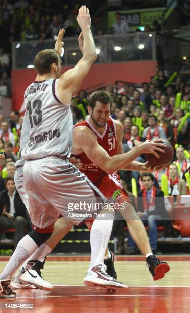 Jared Homan of Bayern Muenchen fights against Guido Gruenheid of Artland Dragons during the basketball Bundesliga match between FC Bayern Muenchen...