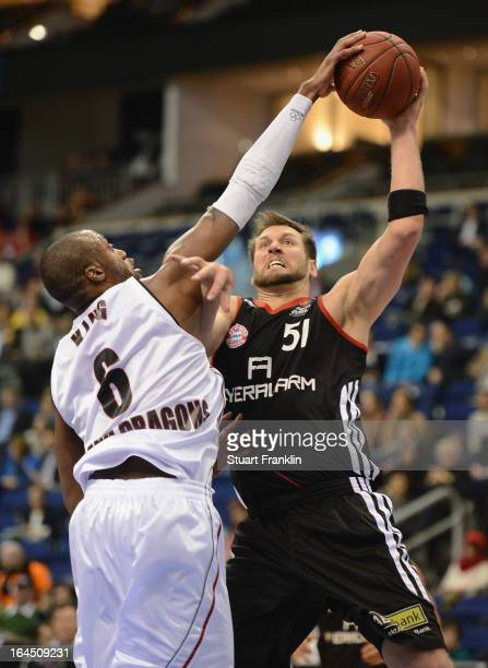 Jared Homan of Muenchen is challenged by Anthony King of Artland during the third place match between FC Bayern Muenchen and the Artland Dragons at...