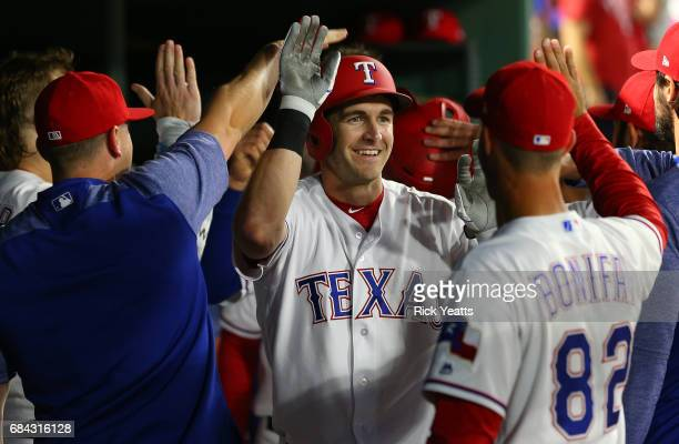 Jared Hoying of the Texas Rangers is congratulated for hitting a tworun home run in the fifth inning against the Philadelphia Phillies at Globe Life...