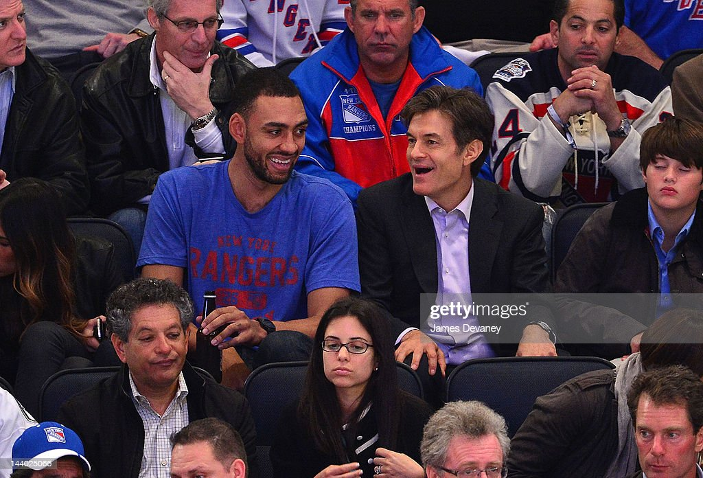 Jared Jeffries and Dr. Oz attend the Washington Capitals vs New York Rangers playoff game at Madison Square Garden on May 7, 2012 in New York City.