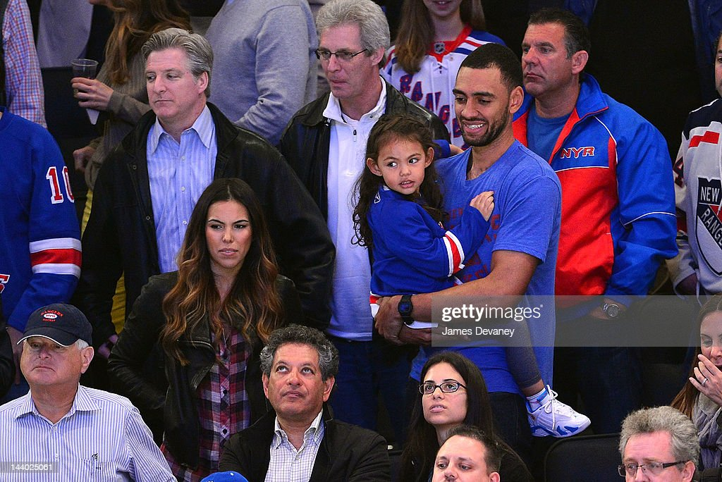 Jared Jeffries and family attend the Washington Capitals vs New York Rangers playoff game at Madison Square Garden on May 7, 2012 in New York City.