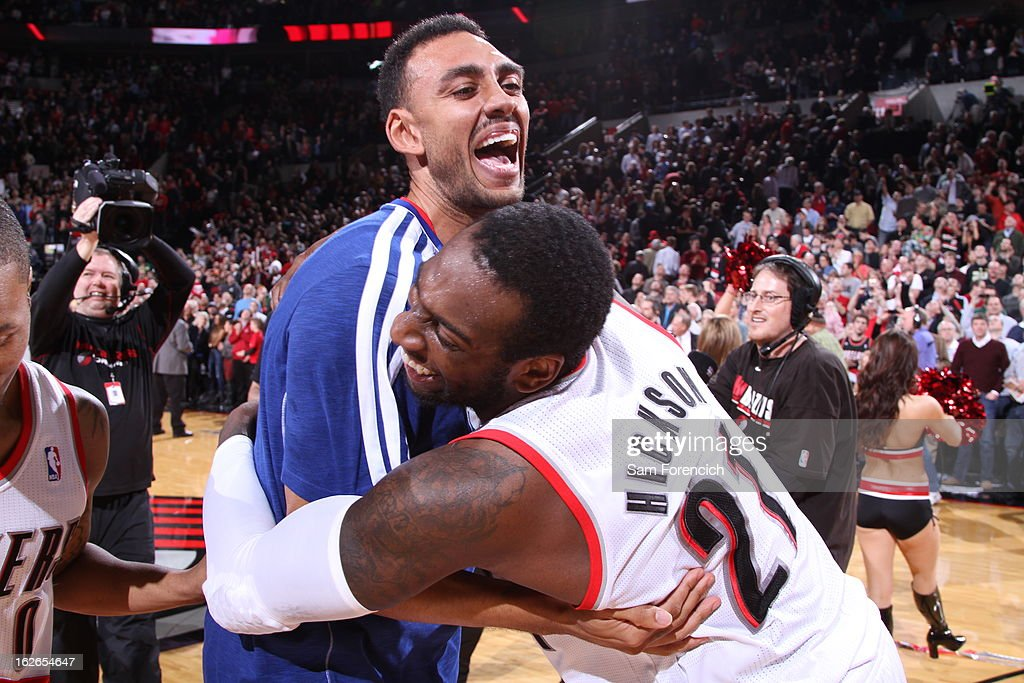 Jared Jeffries #1 and J.J. Hickson #21 of the Portland Trail Blazers hug each other after the game against the Dallas Mavericks on January 29, 2013 at the Rose Garden Arena in Portland, Oregon.