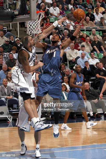Jared Jeffries of the Washington Wizards gets to the hoop against Carlos Boozer of the Utah Jazz on March 23 2006 at the Delta Center in Salt Lake...