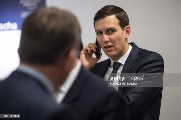 Jared Kushner advisor and soninlaw of US President Donald Trump speaks on his cellphone before a meeting between Trump and the British Prime Minister...