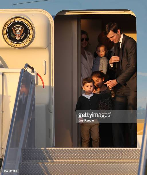 Jared Kushner and his wife Ivanka Trump walk off Air Force One with their children at Palm Beach International airport as they prepare to spend part...