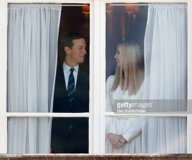 Jared Kushner and Ivanka Trump look out of a window of Buckingham Palace during the Ceremonial Welcome in the Buckingham Palace Garden for US...