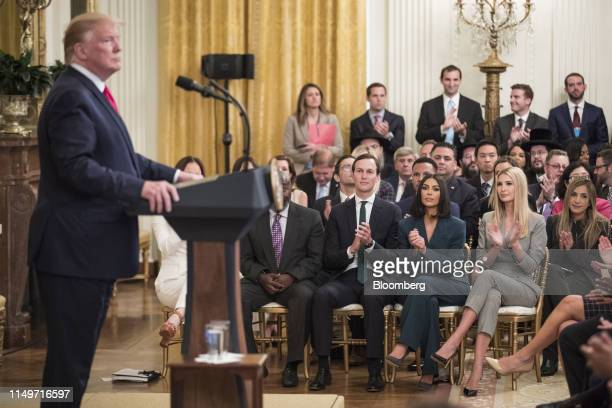 Jared Kushner, from seated left, reality star and activist Kim Kardashian West, and Ivanka Trump listen as U.S. President Donald Trump, not pictured,...