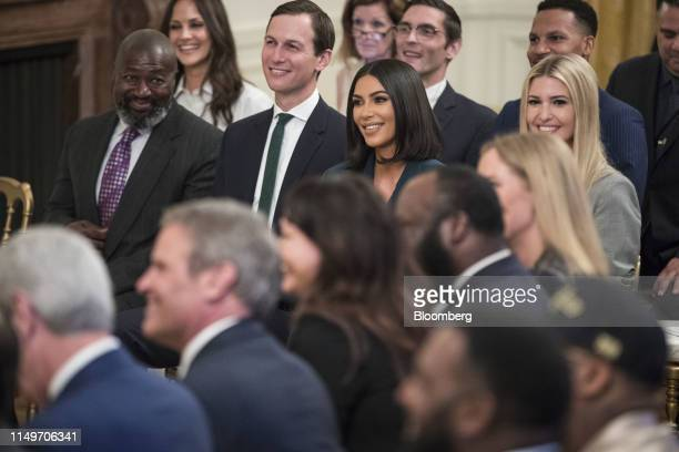 Jared Kushner, from second left, reality star and activist Kim Kardashian West, and Ivanka Trump listen as U.S. President Donald Trump, not pictured,...