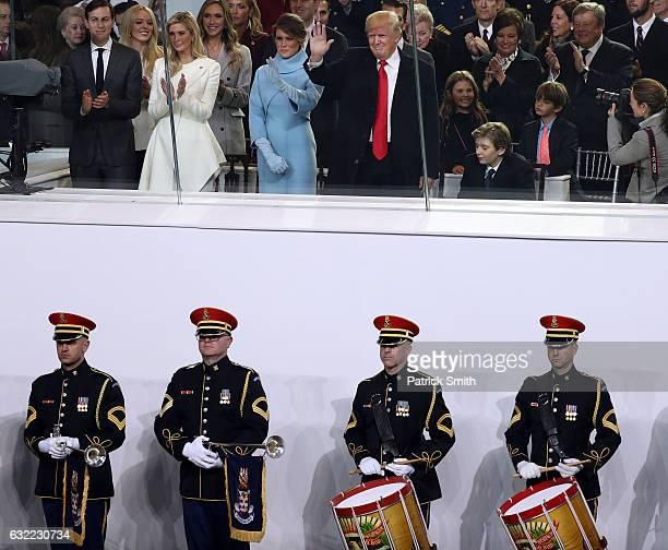 Jared Kushner Ivanka Trump first lady Melania Trump US President Donald Trump and Barron Trump watch the Inaugural Parade from the main reviewing...