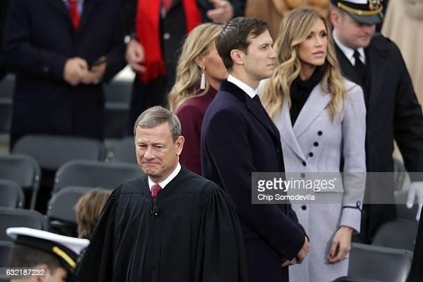 Jared Kushner senior advisor to Presidentelect Donald Trump Lara Trump arrive on the West Front of the US Capitol on January 20 2017 in Washington DC...